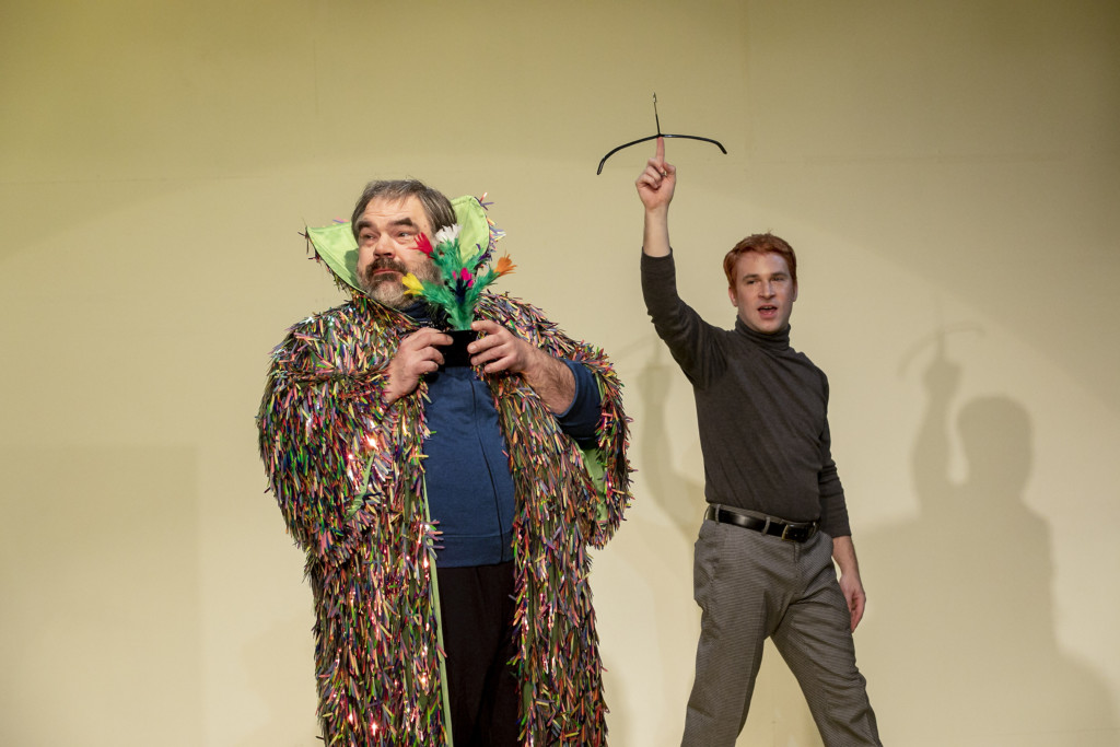 Scene photo of a performance: Two men are on a stage.