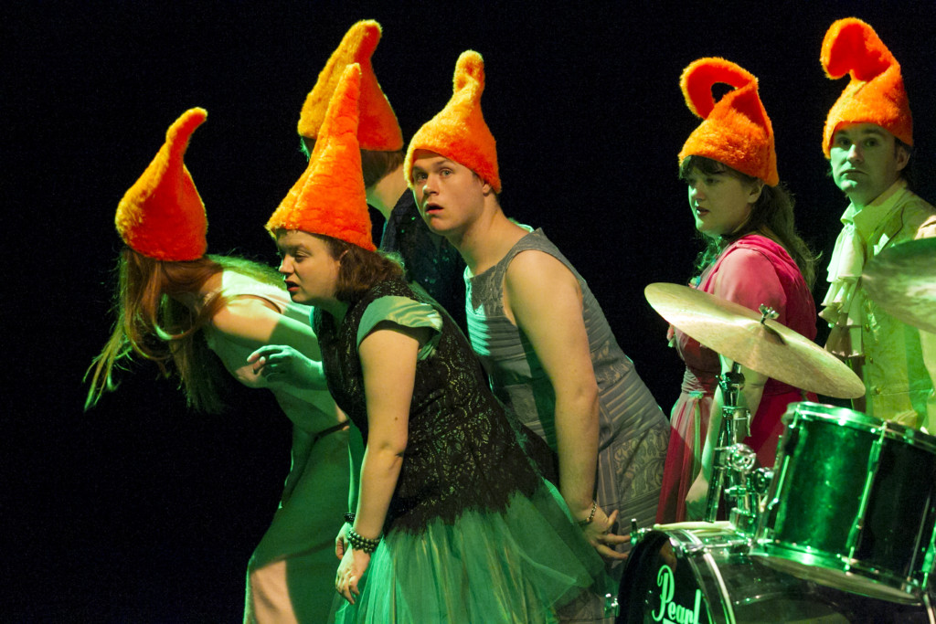 Scene photo of a performance: A couple of people with dwarf hats on a stage.
